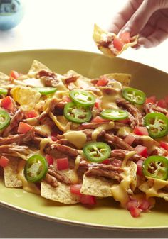 Barbecue Chicken Nachos – Two family favorites—BBQ chicken and cheesy nachos—team up in this easy 15-minute recipe that serves six. The results? Delicious, as predicted!