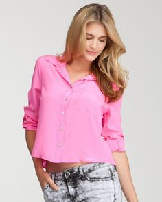 Casual, luxurious and pink! What more can you ask for? (bebe Cropped Hidden Placket Silk Shirt, $109, SKU 198390)
