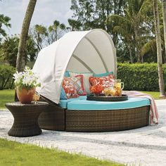 With 231 cu. ft. of space, our versatile, all-weather Baleares daybed serves as a private lounger or seating for six. The handsome Bronze wicker imparts a    breezy, tropical feel and new designer cushions enliven the look with pattern and dimension. For privacy, simply push the four pieces together and extend    the canopy. For socializing, let the canopy down and pull the pieces apart with ease. See the Frontgate Difference.             High-performance wicker is wrapped around all-weat...