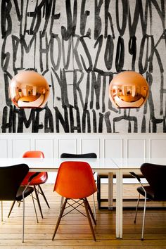 Graphic black and white wallpaper in dining space with rose gold bulb light fixtures
