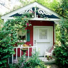 Precious cottage in the garden - perhaps a guest house.  Wouldn't it be lovely to have a cottage of one's own right in your own backyard????