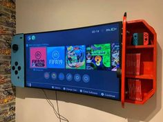 Wall-Mounted Cabinets Turn Your TV Into a Giant Nintendo Switch - Nintendo Switch TV Cabinets Nintendo Room, Super Nintendo, Nintendo Games, Nintendo Decor, Nintendo Characters, Gaming Room Setup, Gaming Rooms, Cool Gaming Setups, Gaming Wall Art