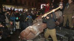 Protestors in Ukraine Topple Lenin Statue as Protests Continue