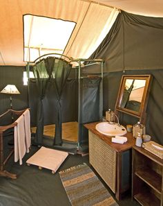 Classic safari bathroom - en suite for every tent at Porini Rhino Camp...re-create this in my tent?