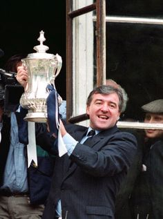 Spurs manager Terry Venables proudly shows the FA Cup to the crowds of supporters cheering below Tottenham Town Hall Tottenham Wallpaper, Tottenham Hotspur Players, Soccer Academy, Academy Logo, London Pride, White Hart Lane, Association Football, Most Popular Sports, North London
