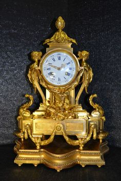 A Neoclassical Probably French Vasiform Porcelain Mantel Clock, On Top A  Tole Jardiniere With Flower | PENDULE Antique UHREN | Pinterest | Kamin  Wand, ...