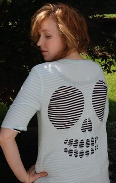 Cutout Skully Tee..... Cut and Slice then where your creation over another shirt.