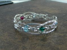 Mothers Bracelet:  Can be made in Sterling, Sterling Filled or Craft Wire.  Craft Wire is at $40