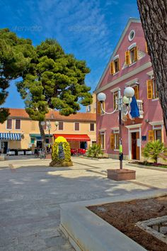 Biograd na moru central square ...  adriatic, architecture, biograd, biograd na moru, blue, building, cafe, center, city, city hall, colorful, croatia, dalmatia, dalmatian, eaterfront, europe, flag, government, green, hall, historical, history, mediterranean, old, park, paved, pink, public, sky, square, street, town, trees, urban, vertical, view, village, walkway, windows