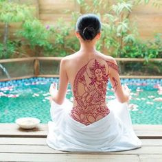 Or do all that but put Tara image as the dominant tattoo (as in: the root chakra is amongst the lotus petals, the mantra is worked into the circle that encompasses Tara-as seen in this pic)