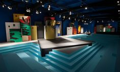 Prada For her latest show, Miuccia Prada took tropical prints and gave them a gloomy, subdued feel. The set - conceived once again by OMA's think tank AMO - represented a 'menacing paradise', a ghost town of buildings that referenced the collection's prints.