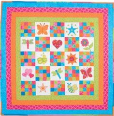 Fun mix of colors in a combination of nine patch and appliqué quilt. Squares and More Baby Quilt