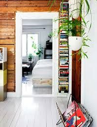 Bookshelf Very light, natural feel but modern too. Knotty Pine Decor, Knotty Pine Walls, Painted Wooden Floors, Classic Living Room, Scandinavian Interior Design, Cottage Interiors, Log Homes, My Dream Home, Interior Inspiration