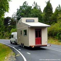 Brett's tiny house on the move. I have to say, I have seen a lot of tiny homes, but the design of this one really reaches me. Tiny House Trailer, Tiny House On Wheels, Micro House Plans, Tiny House Wood Stove, Shipping Container Home Builders, Tiny Mobile House, Tiny House Community, Compact House, Tiny House Bathroom