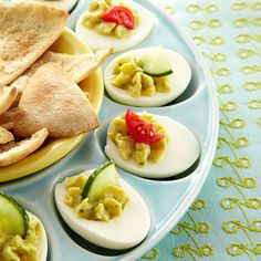 These favorite potluck appetizers use fat-free Greek yogurt instead of mayo and add chickpeas to a tangy yolk mix that features lemon juice and mustard. Three egg halves make a perfect 100-calorie snack.