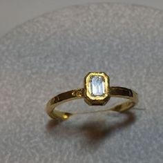Emerald cut diamond and 18k ring