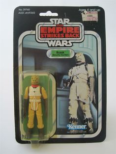 "Classic action figure for the bounty hunter Bossk, from the ""Star Wars: The Empire Strikes Back"" line of toys from Kenner. It even has a price sticker from the now-defunct Lionel Kiddie City chain of toy stores."