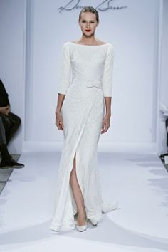 simple wedding sheath with long sleeves | swoon over more long sleeved #wedding dresses here: http://www.mywedding.com/articles/2014-trending-fall-dresses-with-sleeves/