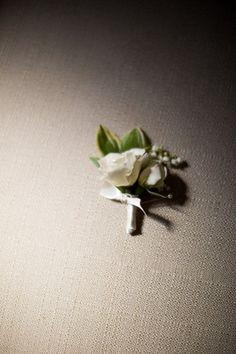 Simple White Boutonniere | A Romantic Charleston Wedding via TheELD.com | Southern Protocol, and Paige Winn Photo