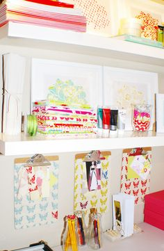 organizational needs by adhering scrapbook paper or fabric to a plain clipboard.  Pretty & smart!