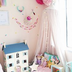 Pretty girl's room with Le Toy Van Cherry Tree Hall dollhouse, Rabbit dolls by miniroom.se, and canopy.
