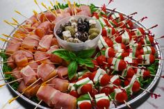 Proscuetto & Melon, Caprese Skewers, w/Tri Olives & Feta Party Platter