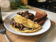 [Homemade] A simple but very photogenic mushroom red onion and white cheddar omelette Omelettes, White Cheddar, Onion, Food Porn, Stuffed Mushrooms, Toast, Cooking Recipes, Homemade, Drink