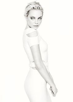 Emma Stone >> Always beautiful! I love though how she seems to blend in with the background... very cool effect.