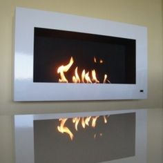 Modern fireplace and smart contemporary hearth with remote-controlled automatic ignition by AFIRE. An innovative high-tech fireplace collection Wall Mounted Fireplace, Small Fireplace, Aesthetic Value, Creativity And Innovation, Electric Fireplace, Hearth, Foyer, House Warming, Interior Decorating