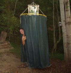 She had the idea to make a shower enclosure out of a hula hoop and shower curtain liners. As you can see, it worked!