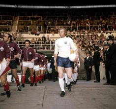 Bobby Moore, leading England out against Malta in 1971.