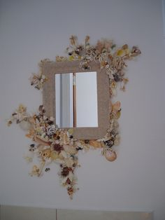 Sand and shell mirror.                                                                                                                                                                                 More