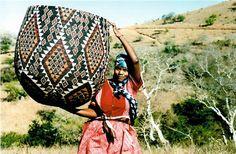 Africa   Tholi Mlotshaw, with her handcrafted Zulu basket.   Image © ZanzibarTrading