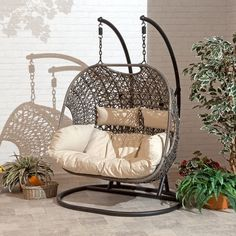 The Brampton is the perfect addition to any outdoor living space. The Brampton double Cocoon hanging chair comes with an espresso brown rattan design, completed with beige Cushions. This swing is supported by a strong and durable aluminum chain and b Wicker Swing, Egg Swing Chair, Hanging Swing Chair, Patio Swing, Swinging Chair, Garden Swing Chair, Patio Decks, Hanging Beds, Swing Seat