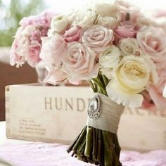 for the maid of honor - all roses, different shades of light pink and white, and little smaller