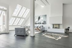 Attic Apartment in Berlin is a private residence renovated by Donatella Mustavic. It is located in Charlottenburg – Wilmersdorf, a borough of Berlin, Germany. It is currently for sale for $2,5 million