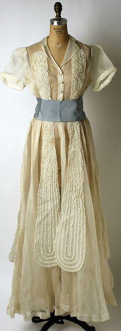 Dinner dress Hattie Carnegie  Design House: Hattie Carnegie, Inc. Date: 1943 Culture: American Medium: cotton, silk Accession Number: C.I.51.70.22a, b