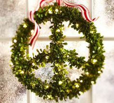 """""""Peace"""" A straightforward message said in an effortless way. Mistletoe makes a lovely greenery for a wreath."""