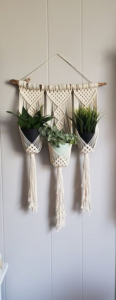 Macrame wall hanging with 3 holders, perfect for small plants or your favorite decorative container! Made with natural, off-white cotton rope. Ombre tips option made with non-toxic dye. Length: approx. 26 in. Width: Macrame design- approx. 14 in. Length of stick will be approx.