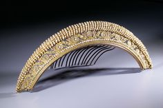 "Superb and rare diadem richly decorated with 4 galeries. The third one has three tones of gold. Small ""rosettes"" are separated with tiny glass beads imitating pearls, the same that surround the twisted edge. A horse head is stamped on the teeth, it was a Revolutionary hallmark. Some teeth on each side have been cut to fit better in the hair. late 18c.  French"