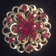 Vintage 3- Dimensional Goldtone and Red Rhinestone 4 layered Flower Shaped Brooch on Etsy, $14.95