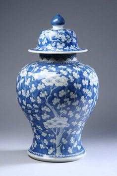 CHINESE BLUE AND WHITE PORCELAIN JAR AND COVER, Kangxi period. Prunus blossom decoration - 17 1/2 in. high