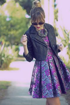 Love this combination of ladylike dress & leather jacket