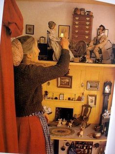 Tasha Tudor with her dollhouse. This dollhouse is about 6 feet long and 4 feet high, and everything about it is hand made. Just read this and it has to be taller than 4 feet. Tasha Tudor wasn't 3 feet tall. Just saw another pin it's on a huge base.