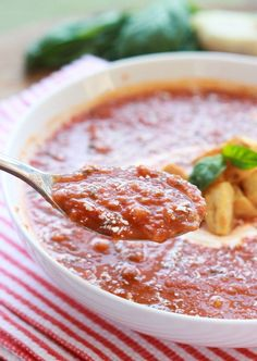 Ina Garten's Roasted Tomato Basil Soup - roasted tomatoes simmered in homemade stock with loads of basil! This is an ultimate comfort soup that is dairy free, light on calories, and make it vegan with only one ingredient swap | littlebroken.com @littlebroken #soup #inagarten #tomatosoup