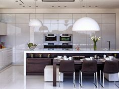White kitchen in Perfect modern mansion in Beverly Hills Tap the link now to see where the world's leading interior designers purchase their beautifully crafted, hand picked kitchen, bath and bar and prep faucets to outfit their unique designs.