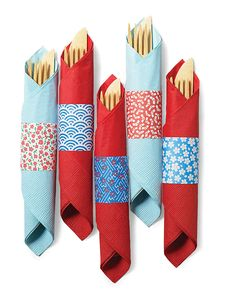 Origami Paper Napkin Rings | Martha Stewart Living - Playful patterned cuffs spiff up paper napkins and make it a breeze for guests to grab their flatware at a barbecue buffet.