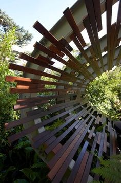 Curved steel and timber pavilion by Dean Herald or Rolling Stone Landscapes. - other - Dean Herald-Rolling Stone Landscapes