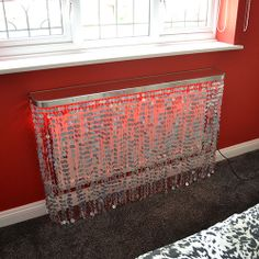 Silver hologram with a red LED lighting effect - a graduated Ombre colour statement - perfect with a solid pillar box red wall and grey carpet as backdrops.