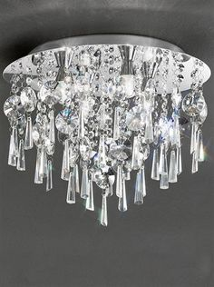 400mm Flush IP44 Crystal Chrome finish circular flush ceiling fitting with a mass of crystal glass drops. Rated IP44. Supplied with lamps.